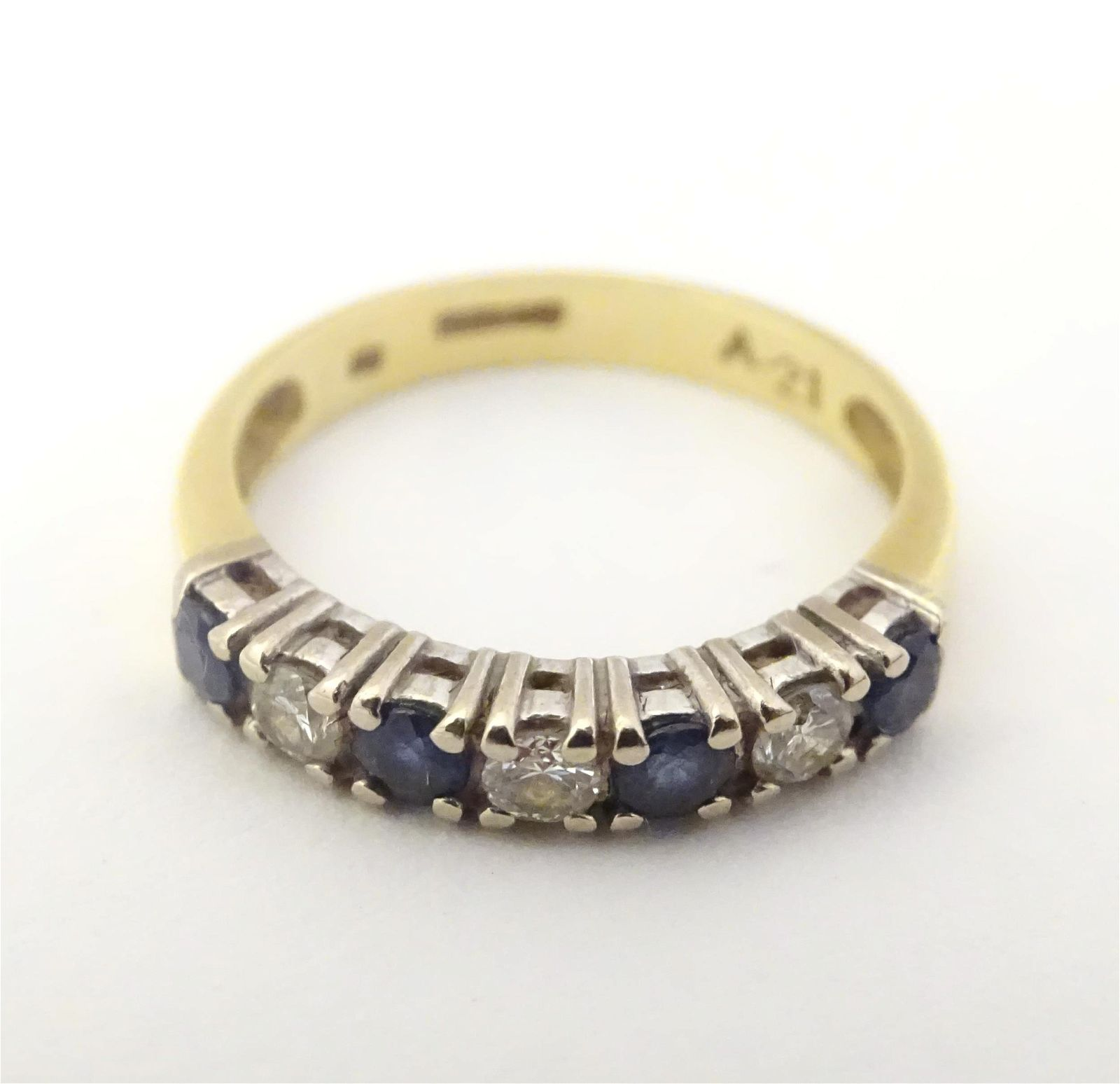 An 18ct gold ring set with diamonds and sapphires in a