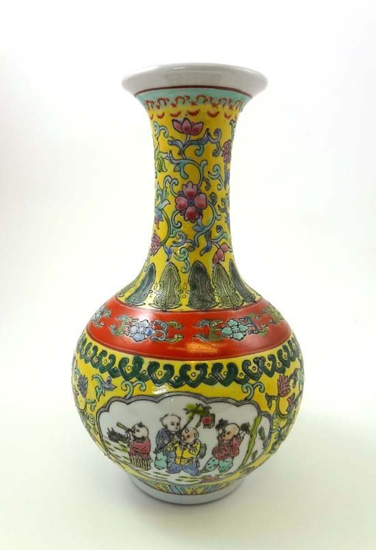 353: A Chinese porcelain bottle vase decorated in brigh