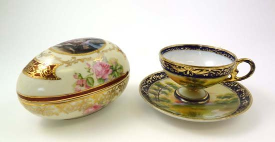 355: A Noritake cabinet cup and saucer, painted with a
