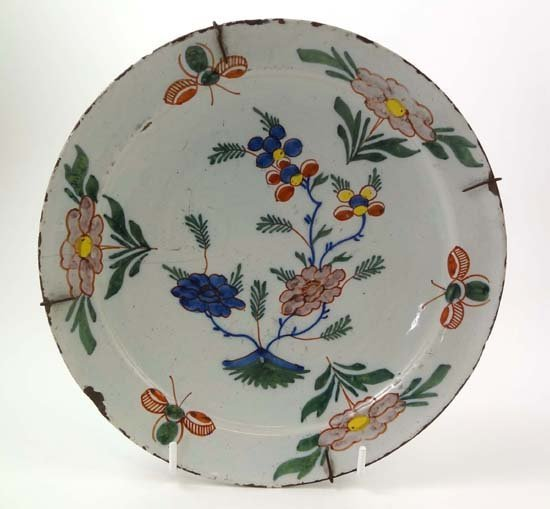 357: An 18thC Dutch delft polychrome plate painted with
