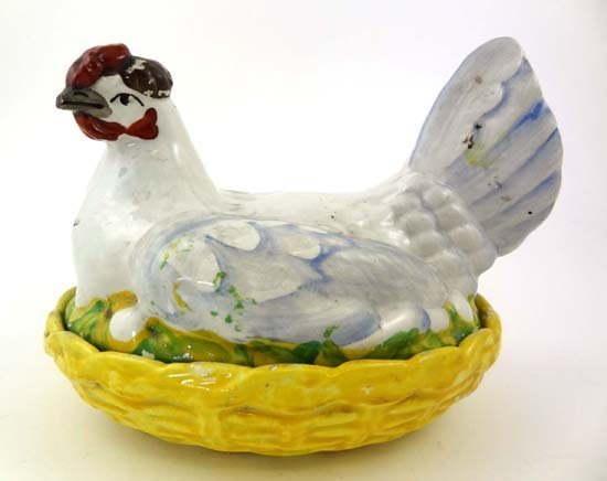 359: A Victorian Staffordshire hen on nest, having red