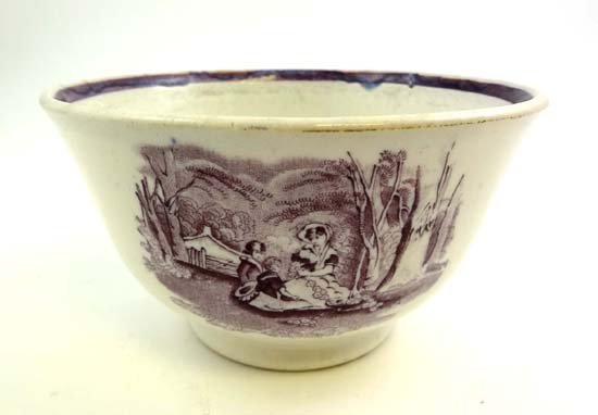 361: A 19thC pottery purple bat printed slop bowl with