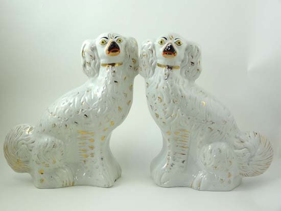 363: A pair of Victorian Staffordshire white Spaniels h
