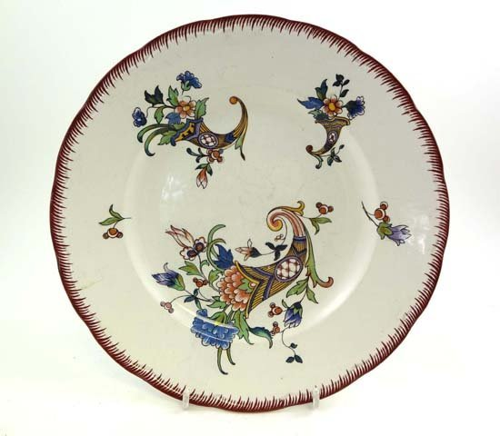 369: An early 20thC French pottery plate by Sarreguemin