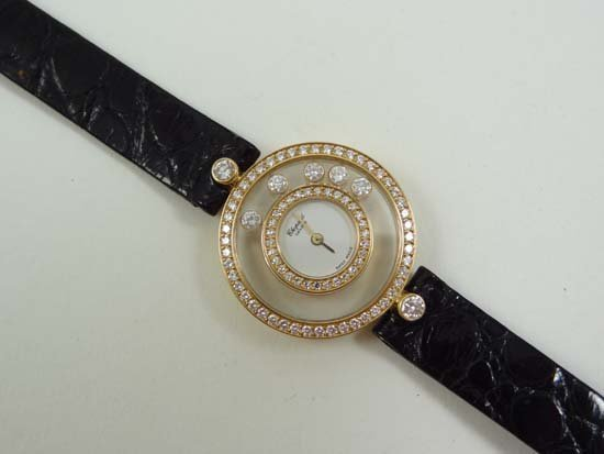 775: Ladies Watch ; CHOPARD. A fine 18ct white gold and