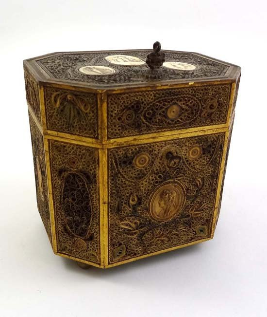 813: A 19thC scroll paper octagonal tea caddy with plas