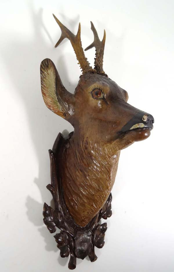 78: An early 20th C Black Forest carved and painted woo
