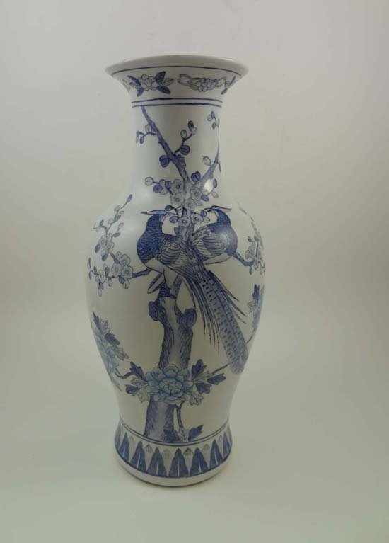 351: A blue and white Oriental vase decorated with exot