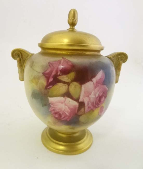 354: A Royal Worcester covered urn painted with a profu