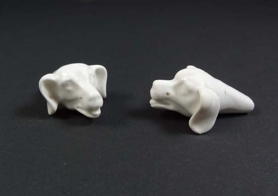 363: Two white glazed porcelain whistles in the form of