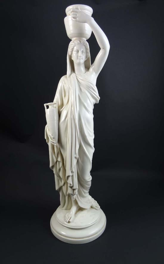 365: A Royal Worcester white glazed figurine depicting