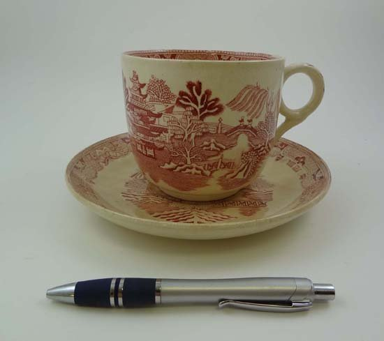 373: A late 19thC large cup and saucer decorated with r