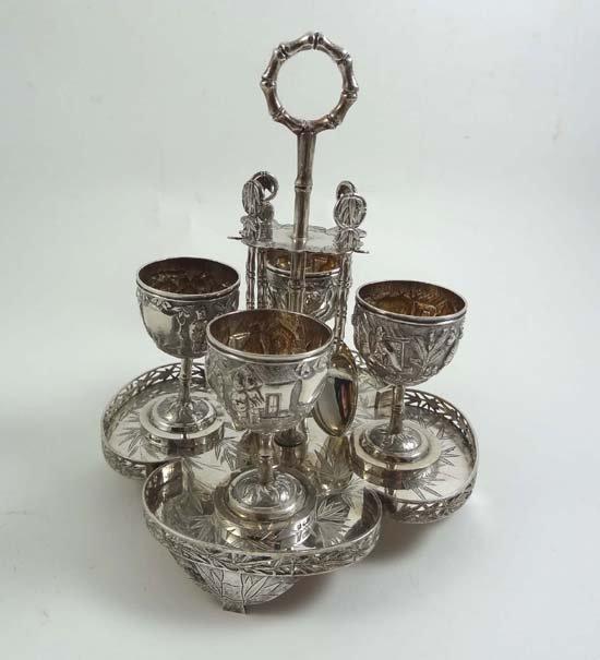 551: Chinese Export silver : An egg cruet comprising tr