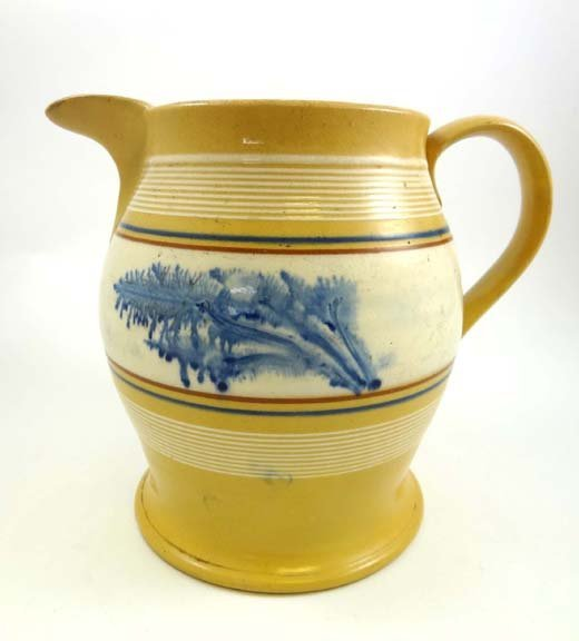 352: A 19thC Mocha jug decorated with horizontal bands