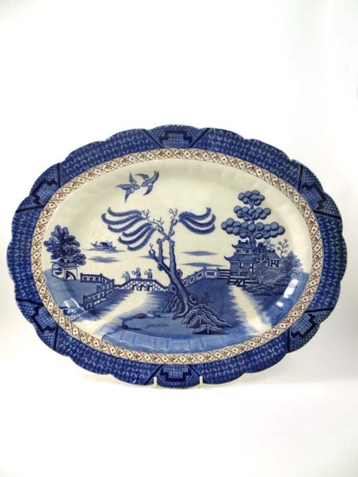 358: A Booths oval shaped meat dish decorated in Real O