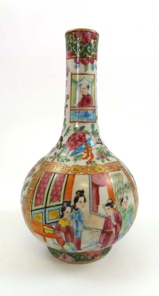 368: An 18thC Chinese famille rose vase having long nec
