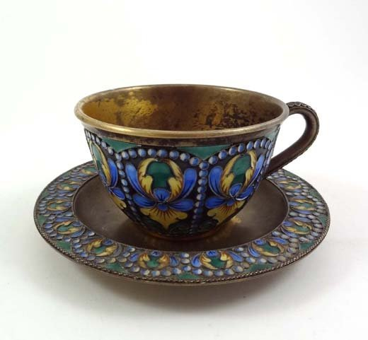 842: A Russian silver gilt Cloisonné cup and saucer . M