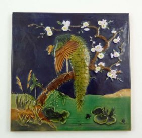 A 19thC Majolica Moulded Tile Depicting An Exotic