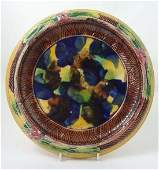 352: A 19thC Majolica bread plate decorated in mottled