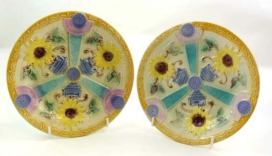 356: A pair of polychrome majolica plates decorated wit