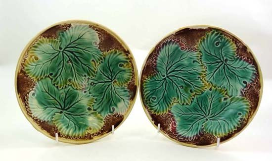 357: A pair of moulded majolica leaf plates, decorated