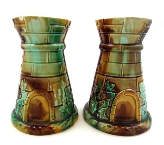 359: A pair of novelty majolica vases in the form of st