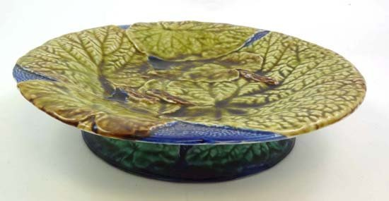 363: A polychrome majolica short tazza moulded with det