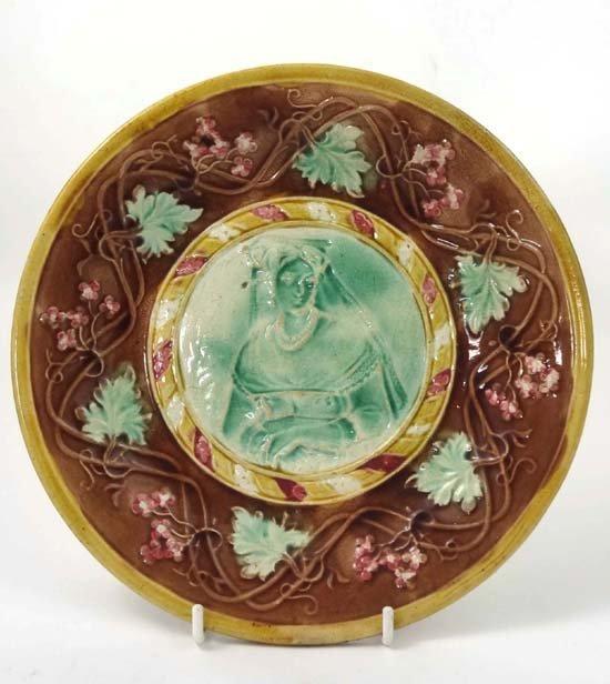 364: An Art Nouveau polychrome Majolica plate depicting