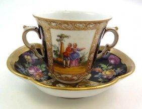 An 18thC Porcelain Chocolate Cup And Saucer Of Qua