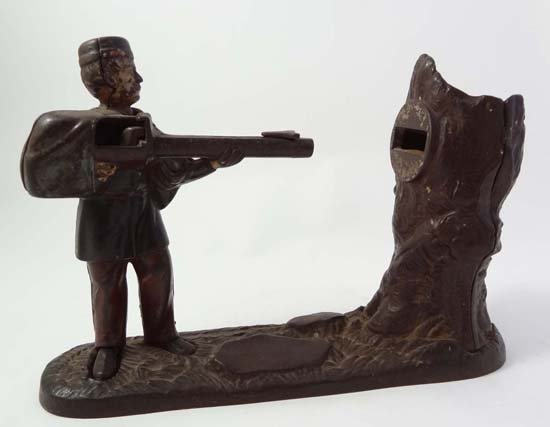 A polychrome cast iron mechanical novelty money box dep