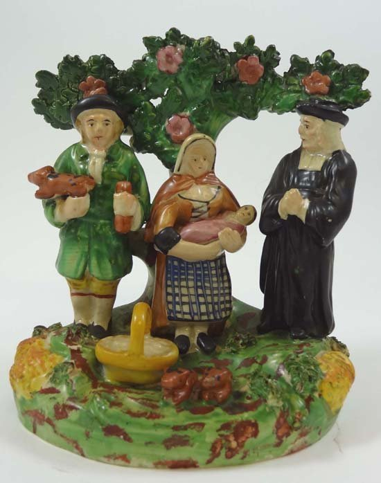 A 19thC Staffordshire bocage figure of the Tithe Pig Gr