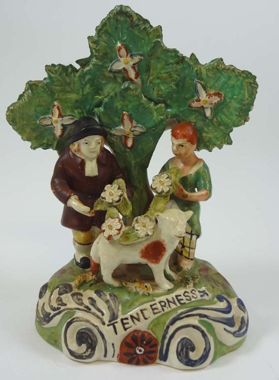 A 19thC Staffordshire figure entitled Tenderness depict
