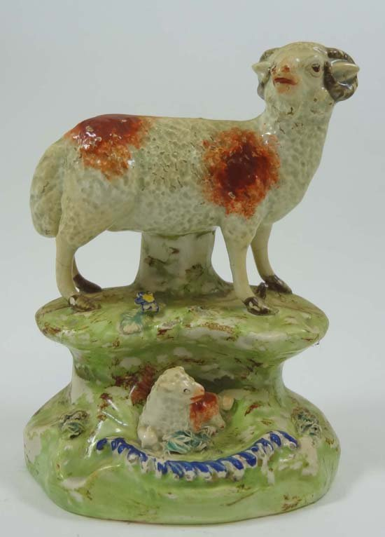 An early 19thC Staffordshire figure depicting a ram wit