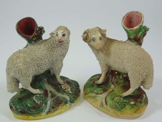 Victorian Staffordshire spill vases depicting a ewe and