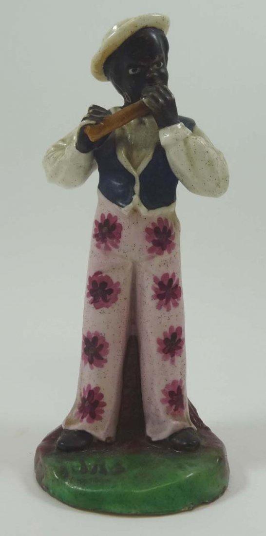A rare Victorian Staffordshire figure modelled as a bla