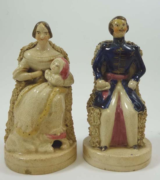 A pair of  Victorian Staffordshire seated figures repre