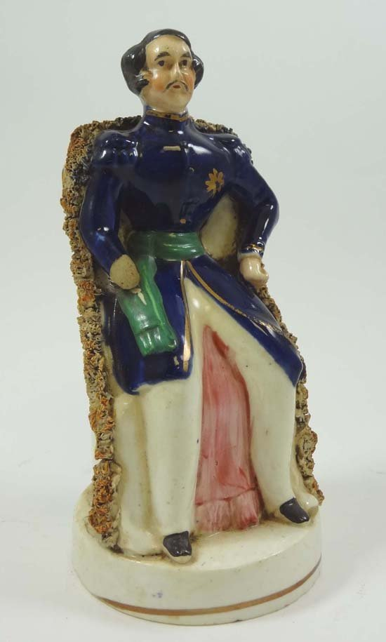 A Victorian Staffordshire polychrome figure depicting a