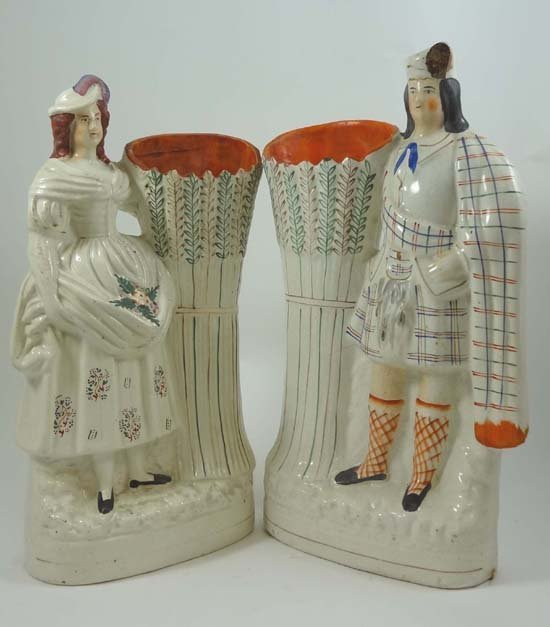 A pair of Victorian Staffordshire spill vases depicting