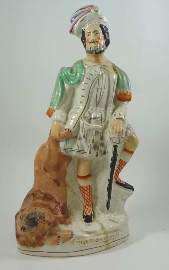 A Victorian Staffordshire figure entitled The Lion Slay