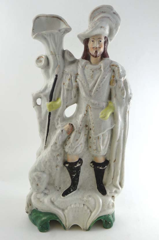 A Victorian Staffordshire tall figure of a Huntsman in