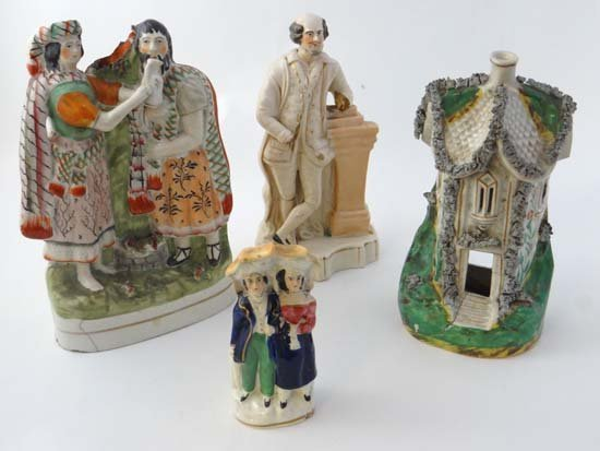 A collection of four Victorian Staffordshire items comp