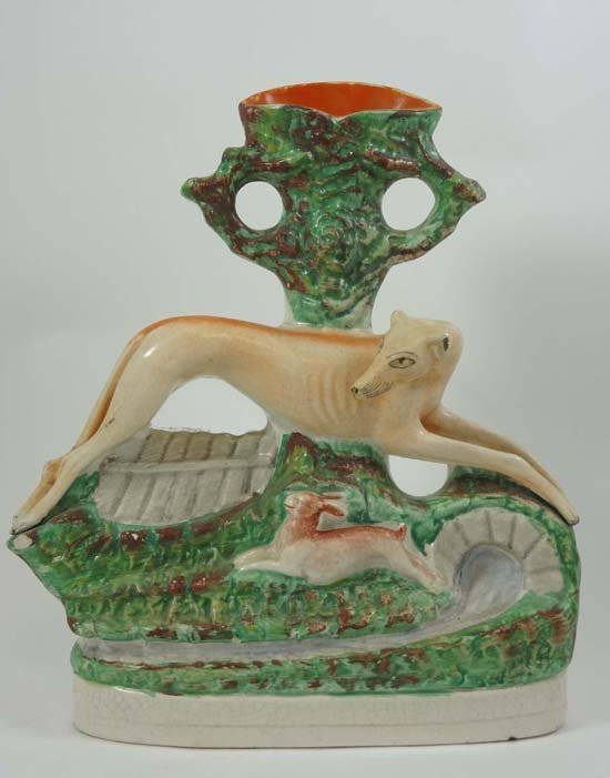 A Victorian Staffordshire spill vase moulded with a run