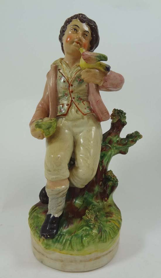A Victorian Staffordshire figure known as Bird Nesting,