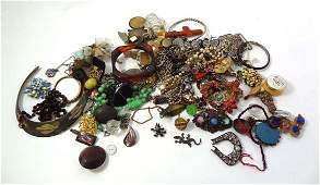 A quantity of assorted jewellery, beads, brooches brace