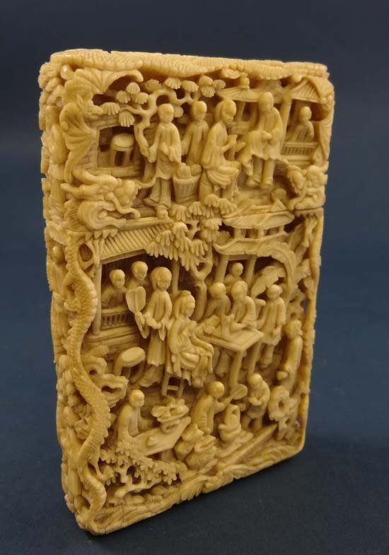 A fine 19thC deep carved Cantonese card case depicting