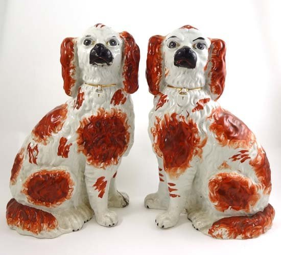 A pair of Victorian Staffordshire spaniels decorated wi