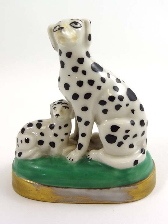A porcelain Sampson figure of a Dalmatian seated beside