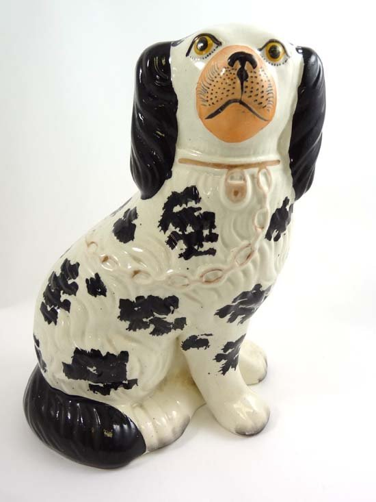 A Victorian Staffordshire spaniel having separate front