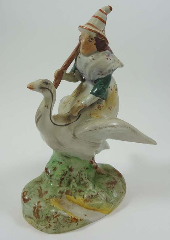 A late Victorian Staffordshire figure of Mother Goose,