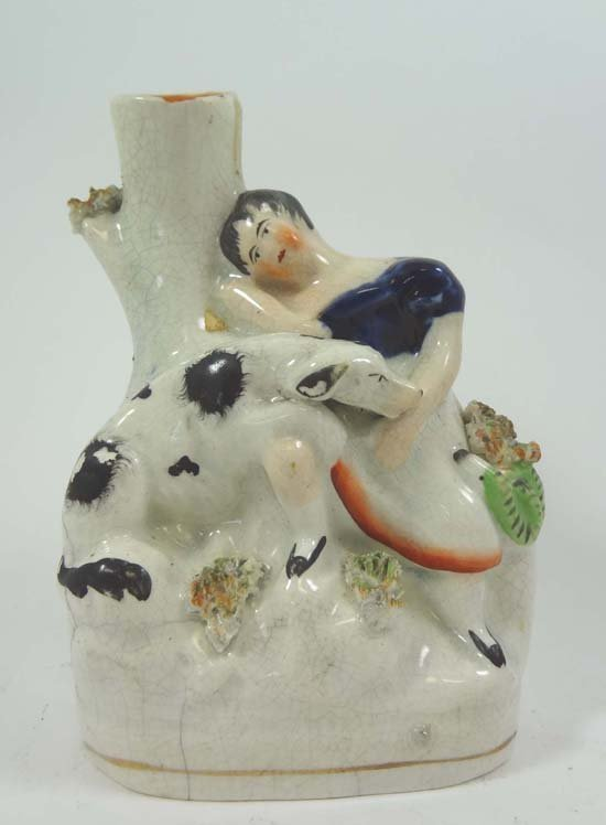 A Victorian Staffordshire spill vase modelled with a gi